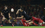 All Blacks centre Sonny Bill Williams finds Conrad Smith in support as he's tackles by Wales pair Dan Biggar and 'Taulupe Faletau.<br /> Dove men Series 2014<br /> Wales v New Zealand<br /> 22.11.14<br /> &copy;Steve Pope -SPORTINGWALES