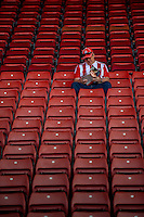 A Southampton fan takes his seat early prior to the Premier League match between Southampton and Swansea City  at St Mary's Stadium in Southampton, England, UK. Saturday 17 September 2016