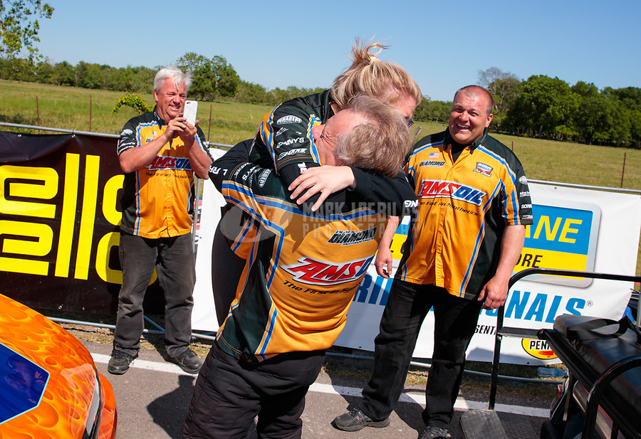 Apr 14, 2019; Baytown, TX, USA; Crew members for NHRA mountain motor pro stock driver John DeFlorian celebrates after winning the Springnationals at Houston Raceway Park. Mandatory Credit: Mark J. Rebilas-USA TODAY Sports
