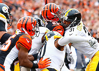 Ross Cockrell #31 of the Pittsburgh Steelers tackles Tyler Eifert #85 of the Cincinnati Bengals along with teammate Ryan Shazier #50 of the Pittsburgh Steelers in the first half during the game at Paul Brown Stadium on December 12, 2015 in Cincinnati, Ohio. (Photo by Jared Wickerham/DKPittsburghSports)