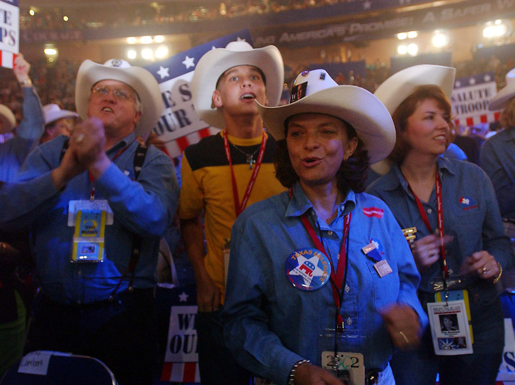 8/30/04/04.2004 REPUBLICAN NATIONAL CONVENTION/TEXAS DELEGATES--Texas delegates Ken Leonard and Joel Fisher, both alternates, and delegate Susan Blair celebrate on the convention floor..CONGRESSIONAL QUARTERLY PHOTO BY SCOTT J. FERRELL