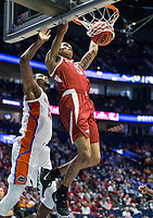 NWA Democrat-Gazette/BEN GOFF @NWABENGOFF<br /> Jalen Harris, Arkansas guard, dunks on Kevarrius Hayes, Florida center, in the first half Thursday, March 14, 2019, during the second round game in the SEC Tournament at Bridgestone Arena in Nashville.