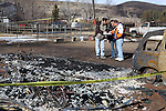 Patrick Watts talks with insurance investigators Saturday, Jan. 21, 2012 after his home was destroyed in Thursday's brush fire. Watts' mother-in-law  June Hargis, 93, died in the fire..Photo by Cathleen Allison
