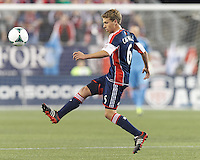 New England Revolution midfielder Scott Caldwell (6) clears the ball.  In a Major League Soccer (MLS) match, the New England Revolution (blue) defeated Columbus Crew (white), 3-2, at Gillette Stadium on October 19, 2013.