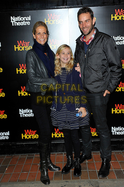 Ulrika Jonsson, guest & Brian Monet.The 5th anniversary performance of 'War Horse' at The New London Theatre, Drury Lane, London, England..October 25th, 2012.full length black jacket grey gray leather stripe dress kid child holding hands married husband wife boots blue scarf .CAP/CJ.©Chris Joseph/Capital Pictures.