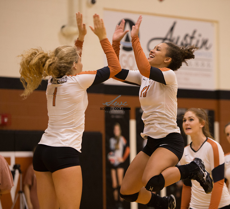 Westwood Warriors Tori Clitheroe (1) and Remy Corbin (10) high five before the start of a high school volleyball match between the Westwood Warriors and the Stony Point Tigers at Westwood High School in Austin, Texas on September 20, 2016.