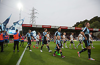 The Teams head onto the field during the Capital One Cup match between Wycombe Wanderers and Fulham at Adams Park, High Wycombe, England on 11 August 2015. Photo by Andy Rowland.