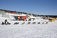 Jeff King returns to White Mountain chkpt to drop dog *Bernard* 2006 Iditarod on Fish River Alaska Winter
