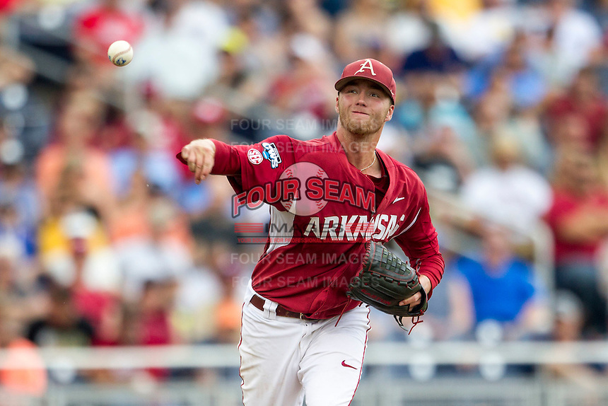Arkansas Razorbacks pitcher Trey Killian (21) makes a pickoff throw to first base against the Virginia Cavaliers in Game 1 of the NCAA College World Series on June 13, 2015 at TD Ameritrade Park in Omaha, Nebraska. Virginia defeated Arkansas 5-3. (Andrew Woolley/Four Seam Images)