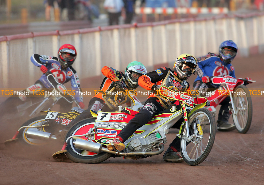 Heat 4 - Christian Hefenbrock (yellow) leads at the end of the back straight ahead of Billy Hamill, Joonas Kylmakorpi (red) and Paul Hurry - Arena Essex vs Wolverhampton Wolves - Skybet Elite League 'B' - 07/06/06 - (Gavin Ellis 2006)