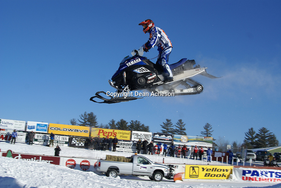 Yuji Nakazawa on #36 takes the bright blue Yamaha Nytro to the checkers to win the Pro Open snocross title at the Eagle River World Snowmobile Championship on Sunday, Jan. 20 at Eagle River, Wis. He grabbed the holeshot and led every lap. The Yamaha test pilot is from Nagano, Japan.