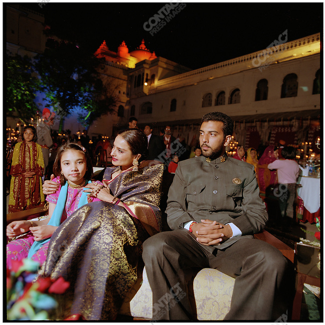 Bollywood actress Rekha sits between Prince Lakshyaraj, son of Arvind Singh Mewar, the 76th Maharana of Udaipur, and his niece, Lokaviaa, daughter of the Prince's elder sister, Princess Bhargavi Mewar. Udaipur, Rajasthan, India, February 2006.
