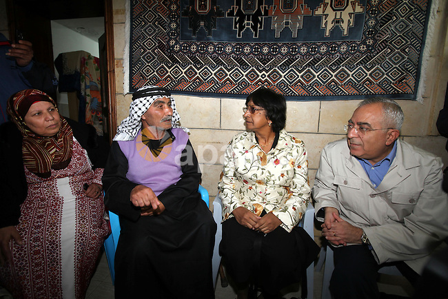 U.N. High Commissioner for Human Rights Navi Pillay and Palestinian prime minister Salam Fayyad visit the Sabri Gareeb Palestinian family home which is situated in the center of the settlement just south of Ramallah in the Israeli occupied West Bank on February 7, 2011. Pillay arrived in Israel for talks with Israeli and Palestinian leaders, UN officials said. Photo by Mustafa Abu Dayeh