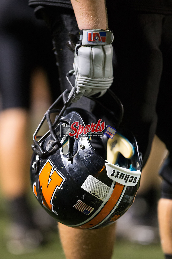 A Northwest Cabarrus Trojans player hold his helmet as time runs down in the game against the A.L. Brown Wonders at Trojan Stadium September 4, 2015, in Concord, North Carolina.  The Wonders defeated the Trojans 56-7.  (Brian Westerholt/Sports On Film)