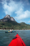 Thailand, Sea Kayaker, Ang Thong National Marine Park, Gulf of Thailand, Susan Johnston paddling a Feathercraft breakdown kayak, released,.