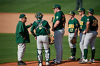 Siena Saints head coach Tony Rossi (40) talks with pitcher Ben Seiler (47), catcher Carson Dunkel (3), Devan Kruzinski (12), Matt Hamel (6), and Eddie Sweeney (20) during a game against the UCF Knights on February 17, 2019 at John Euliano Park in Orlando, Florida.  UCF defeated Siena 7-1.  (Mike Janes/Four Seam Images)