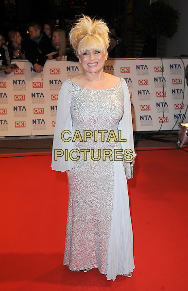 BARBARA WINDSOR.Arrivals at the 15th National Television Awards held at the O2 Arena, London, England. .January 20th, 2010 .NTA NTAs full length silver beaded beads sequins sequined sparkly dress maxi clutch bag .CAP/BEL.©Tom Belcher/Capital Pictures