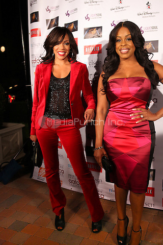 LOS ANGELES, CALIFORNIA - JANUARY 31: Wendy Raquel Robinson and Niecy Nash at the African American Film Critics Association 5th Annual Awards Dinner on Friday Jan 31st, 2014  at the Taglyan Cultural Complex in Los Angeles, California. Photo Credit: RTNjohnson/MediaPunch.