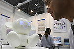 July 30, 2010 - Tokyo, Japan - A man talks to Raytron's communication robot 'Chapit' during Robotech, at Tokyo Big Sight, Japan, on July 30, 2010. The exhibition on the service robot fabrication techniques promotes technology exchange and cooperation.