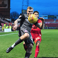Lincoln City's Harry Anderson vies for possession with Swindon Town's Keshi Anderson<br /> <br /> Photographer Andrew Vaughan/CameraSport<br /> <br /> The EFL Sky Bet League Two - Swindon Town v Lincoln City - Saturday 12th January 2019 - County Ground - Swindon<br /> <br /> World Copyright &copy; 2019 CameraSport. All rights reserved. 43 Linden Ave. Countesthorpe. Leicester. England. LE8 5PG - Tel: +44 (0) 116 277 4147 - admin@camerasport.com - www.camerasport.com