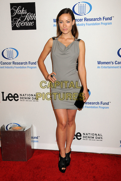OLIVIA WILDE.EIF's Women's Cancer Research Fund Benefit held at the Beverly Wilshire Hotel, Beverly Hills, California, USA..January 27th, 2010.full length sleeveless dress grey gray clutch bag heels black ankle cut out platform peep toe perforated hand on hip.CAP/ADM/BP.©Byron Purvis/AdMedia/Capital Pictures.