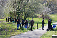 Pictured: A group of young people leave flowers and tributes at Ystrad Mynach Park in south Wales, UK. Saturday 13 April 2019<br /> Re: A 13-year-old boy has died after being found unconscious in Ystrad Mynach Park, Caerphilly County, at about 7.20pm on Friday 12 April.<br /> The teen was taken to University Hospital of Wales in Cardiff where he was pronounced dead.