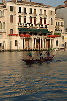 Four men practicing competition rowing, Venice, Italy. May 2007.