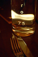 Inside the gate of the restaurant 75, one of the best restaurants in Avignon, run by the same owner as Brunel, a carafe of water backlit back light by a candle highlighting the name 75, knife and fork. Avignon, Vaucluse, Provence, Alpes Cote d Azur, France, Europe