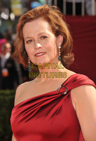SIGOURNEY WEAVER .Arrivals at the 61st Annual Primetime Emmy Awards held at NOKIA Theatre L.A. LIVE, Los Angeles, California, USA..September 20th, 2009.emmys headshot portrait red one shoulder dangling earrings .CAP/ADM/BP.©Byron Purvis/AdMedia/Capital Pictures.