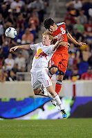 Dax McCarty (11) of the New York Red Bulls and Nathan Sturgis (11) of Toronto FC go up for a header. The New York Red Bulls defeated Toronto FC 5-0 during a Major League Soccer (MLS) match at Red Bull Arena in Harrison, NJ, on July 06, 2011.