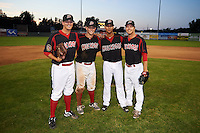 Batavia Muckdogs relief pitcher Brett Lilek, catcher Korey Dunbar, starting pitcher Gabriel Castellanos and relief pitcher Steven Farnworth (L-R) pose for a photo after completing the first perfect game in team history against the Mahoning Valley Scrappers on June 24, 2015 at Dwyer Stadium in Batavia, New York.  Batavia defeated Mahoning Valley 1-0.  (Mike Janes/Four Seam Images)