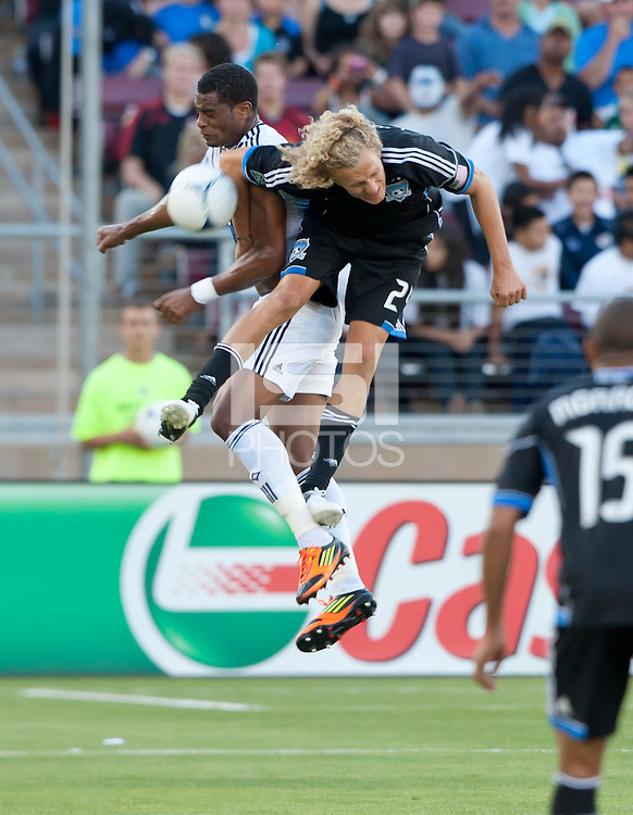 Stanford, California - Saturday June 30, 2012: Steven Lenhart and David Junior Lopes fight for the ball during a game at Stanford Stadium, Stanford, Ca.San Jose Earthquakes defeated Los Angeles Galaxy,  4 to 3