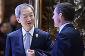 Ahn Ho-young (l), Ambassador of South Korea to the United States, speaks with retired Lt. Gen. Michael Flynn, President-elect Donald Trump's pick for National Security Adviser,  in lobby of the Trump Tower in New York, NY, on January 4, 2017. <br /> Credit: Anthony Behar / Pool via CNP