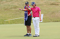 Kristoffer Broberg (SWE) trying to read the putt on 16 during Round Three of the 2015 Alstom Open de France, played at Le Golf National, Saint-Quentin-En-Yvelines, Paris, France. /04/07/2015/. Picture: Golffile | David Lloyd<br /> <br /> All photos usage must carry mandatory copyright credit (© Golffile | David Lloyd)