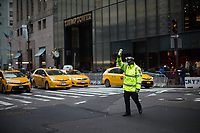 NEW YORK, NY - APRIL 4: A NYPD officers takes care of traffic in front of Trump Tower Where United States First Lady Melania Trump is living on April 4, 2017 in Manhattan, New York. Police Commissioner James O'Neill told lawmakers in February it costs the NYPD between $127,000 and $146,000 a day to protect the first lady and her 11-year-old son Barron. When the president is in town, the city pays more than $308,000.  Photo by VIEWpress/Eduardo MunozAlvarez