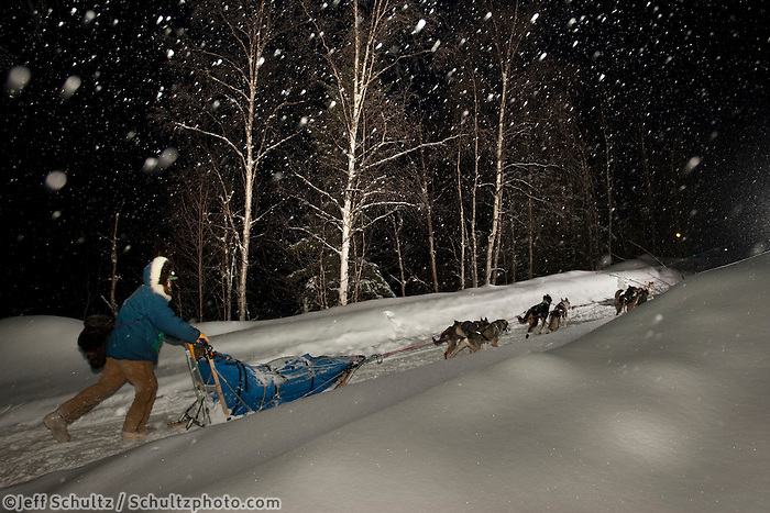 Rookie Musher Wade Marrs on the trail during a light snowfall shortly after leaving the Takotna checkpoint during Iditarod 2009