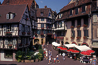 France, Colmar, Alsace, Haut-Rhin, Europe, outdoor café, wine region, Half-timbered buildings decorated with colorful flowers in the picturesque town of Colmar, capital of Haut-Rhin, in the wine region of Alsace.