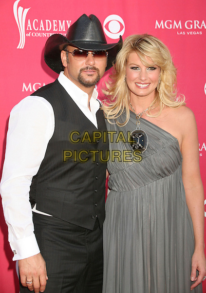 TIM McGRAW & FAITH HILL.42nd Annual Academy Of Country Music Awards held at the MGM Grand Garden Arena, Las Vegas, Nevada, USA..May 15th, 2007.half length black waistcoat sunglasses shades goatee facial hair couple silver grey gray one shoulder dress.CAP/ADM/BP.©Byron Purvis/AdMedia/Capital Pictures