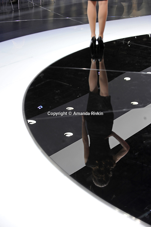 A model shows off cars in the Maserati show room of the Detroit Auto Show in Detroit, Michigan on January 11, 2009.