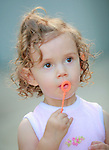 little girl blowing bubbles. David Shwatal portrait photographer Tinley Park Chicago IL 60477