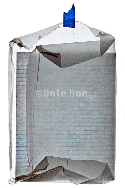 notepad paper in a crumpled semi transparent protection paper folded as an protective envelope