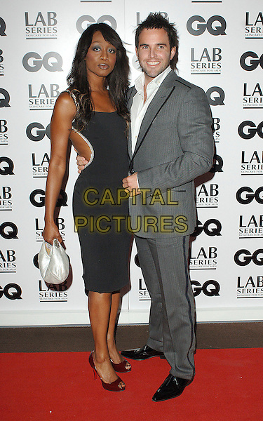 BEVERLEY KNIGHT & guest.The GQ Man Of The Year Awards 2007, Royal Opera House, London, England..September 4th, 2007.magazine full length grey suit black dress gray .CAP/ BEL.©Tom Belcher/Capital Pictures.