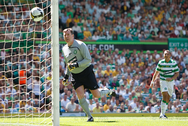 Pat Bonner turns to see Scott McDonald's shot hit the back of his net