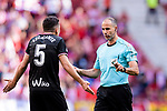 FIFA Referee Alvarez Izquierdo (R) talks to Gonzalo Escalante of SD Eibar (L) during the La Liga match between Atletico Madrid and Eibar at Wanda Metropolitano Stadium on May 20, 2018 in Madrid, Spain. Photo by Diego Souto / Power Sport Images