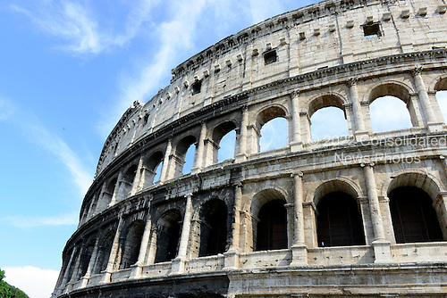 Exterior photo of the top architecture of the remaining outer wall of the Colosseum, also known as the Flavian Amphitheatre, showing some of the two hundred and forty brackets or corbels, that held a tall beam of wood that supported the awning or velarium, in Rome, Italy on Friday, May 25, 2012.  The Ionic and Corinthian arches are also clearly visible..Credit: Ron Sachs / CNP