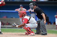 Williamsport Crosscutters catcher Wilson Garcia (25) and umpire Christopher Stump during a game against the Batavia Muckdogs on July 27, 2014 at Dwyer Stadium in Batavia, New York.  Batavia defeated Williamsport 6-5.  (Mike Janes/Four Seam Images)