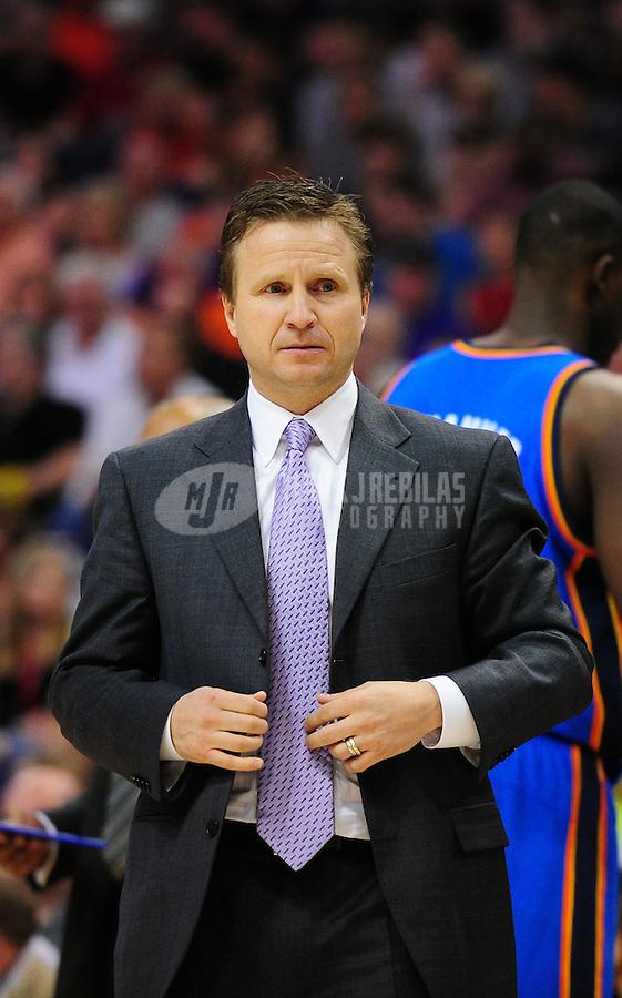 Mar. 30, 2011; Phoenix, AZ, USA; Oklahoma City Thunder head coach Scott Brooks against the Phoenix Suns at the US Airways Center. Mandatory Credit: Mark J. Rebilas-