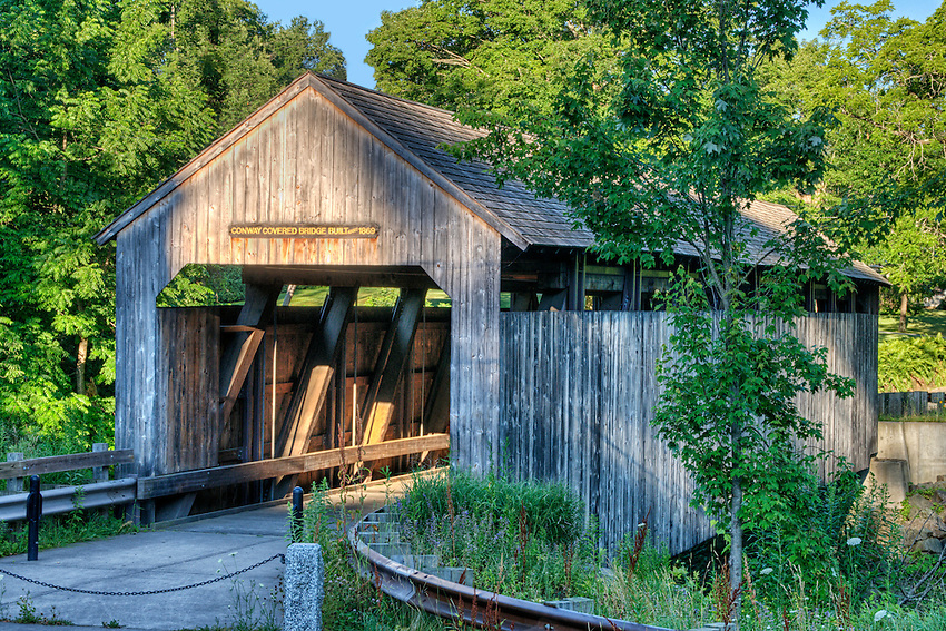 Covered bridge in Conway, Massachusetts, built 1869, in a photo taken just after sunrise