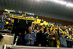 "Beitar Jerusalem soccer fans draped in the team's black-and-yellow colours support their team during the match for the league against Hapoel Tel Aviv in the Jerusalem stadium ""Tedy"". Hapel Tel Aviv is considered by Betar fans  the worst enemy in the league which represents the Ashkenazy (European born) lefty club.  Beitar won the match 2 -1. Beitar Jerusalem FC was founded in the 1930's by the right-wing Revisionist Zionist movement, which later formed the Israeli Likud political party, during the British Mandate rule over Palestine. The chanting of the club is racist and mainly against Arabs. The team is the only one in the Israeli league to have never had an Arab player. Beitar is seen as the right wing and Mizrahi (Jews who came from Asia and Africa) club. Photo by Quique Kierszenbaum"