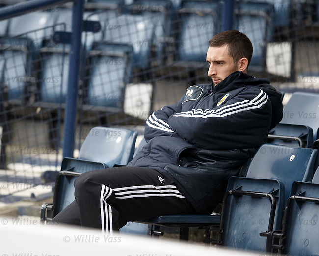 A gloomy looking Lee Wallace sits out training in the stands as he watches his Scotland team mates prepare for the World Cup Qualifier against Croatia on tuesday night